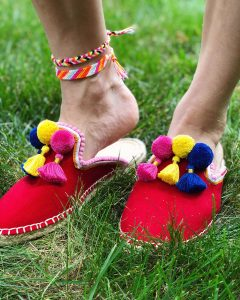 woman shops world pom pom tassel shoe DIY
