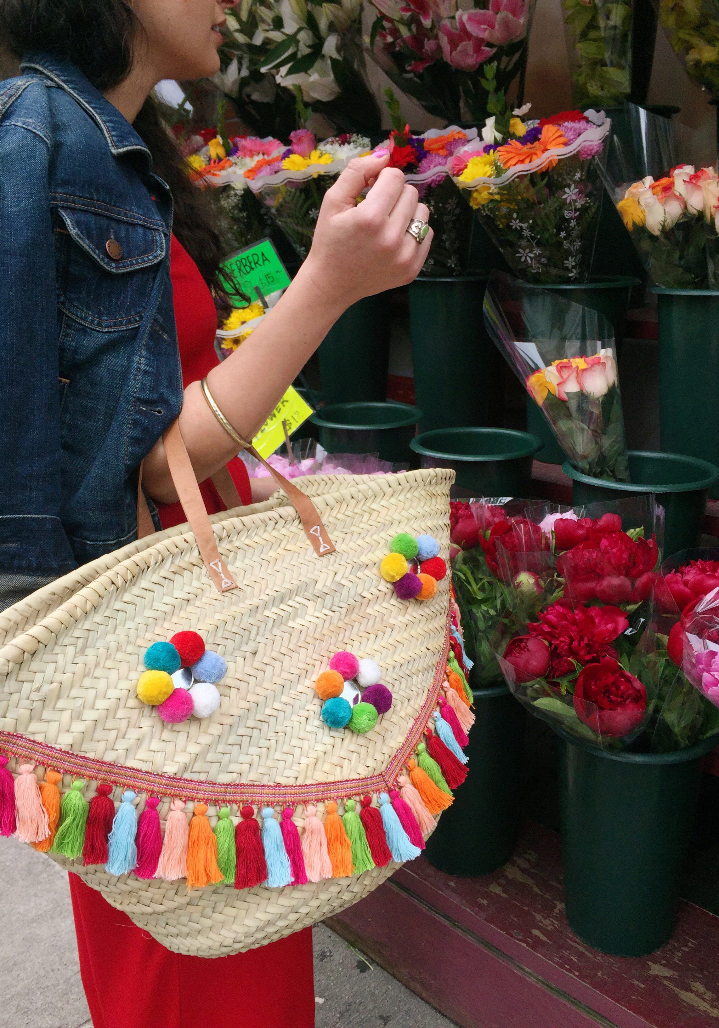 Make a festive straw tote with tassel trim and pompoms from Woman Shops World!